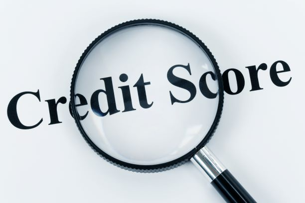 checking credit score through a magnifying glass