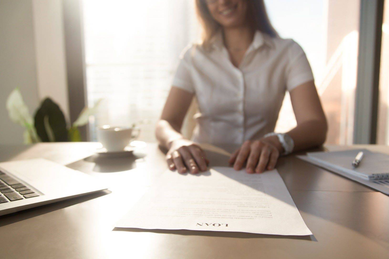 Woman works on her personal loan application