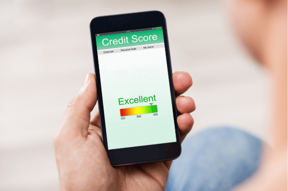 Man holding smart phone showing credit score on a screen