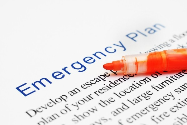 emergency plan documents and a marker