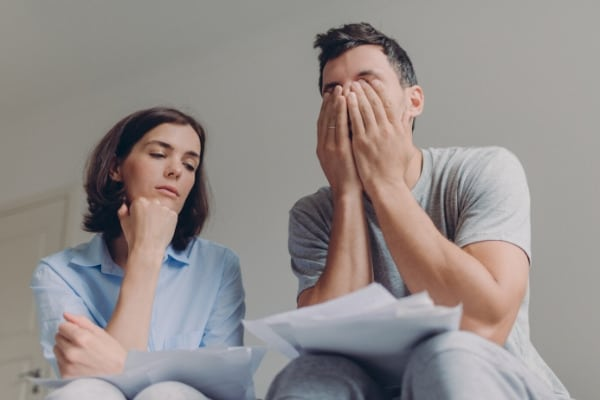 Couple are stressed about finance when emergency appears