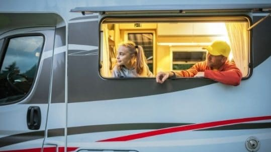 Happy family spending time in motorhome