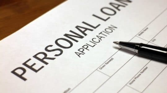 Someone filling out personal loan application