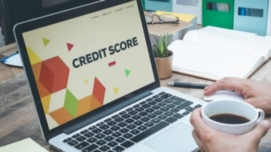 """Words """"Credit Score"""" showing on a laptop screen"""